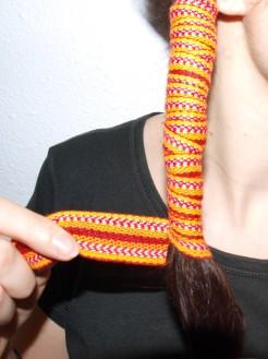 Enrouler jusqu'au bout et ensuite faire un nœud.